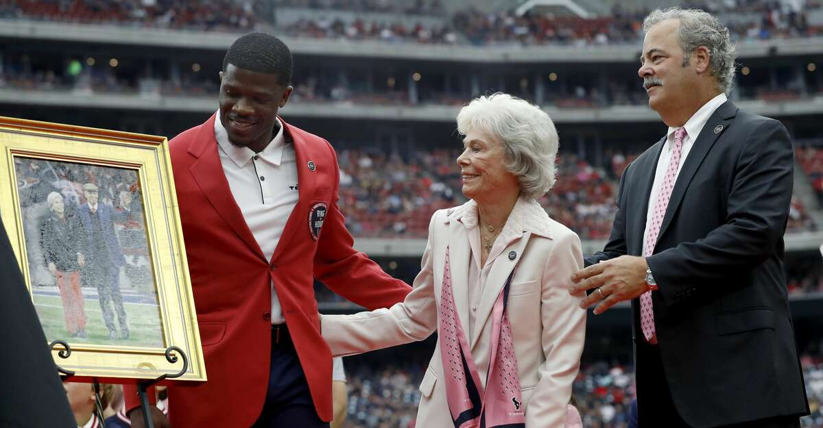 Texans great Andre Johnson, pictured with controlling owner Janice McNair and chairman Cal McNair, made waves with a tweet advising Deshaun Watson to stand his ground with the team and ripping polarizing executive Jack Easterby.