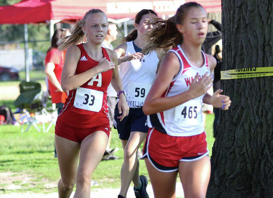 Alton's Jessica Markel (left) passes Granite City's Lauryn Fenoglio near the finish of the Granite City Invite on Sept. 7. Markel posted her fastest time of the season Saturday in the Peoria Invite at Detweiller Park. Photo: Greg Shashack / The Telegraph