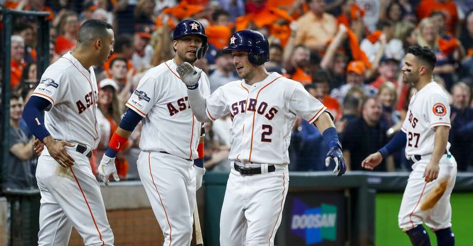 PHOTOS: Astros vs. Rays (Game 2) Houston Astros third baseman Alex Bregman (2) is welcomed back to the dugout by shortstop Carlos Correa (1) and first baseman Yuli Gurriel (10) after hitting a home run during the fourth inning of Game 2 of the American League Division Series at Minute Maid Park on Saturday, Oct. 5, 2019, in Houston. Browse through the photos to see action from the Astros' win in Game 2 of the ALDS against the Rays. Photo: Karen Warren/Staff Photographer