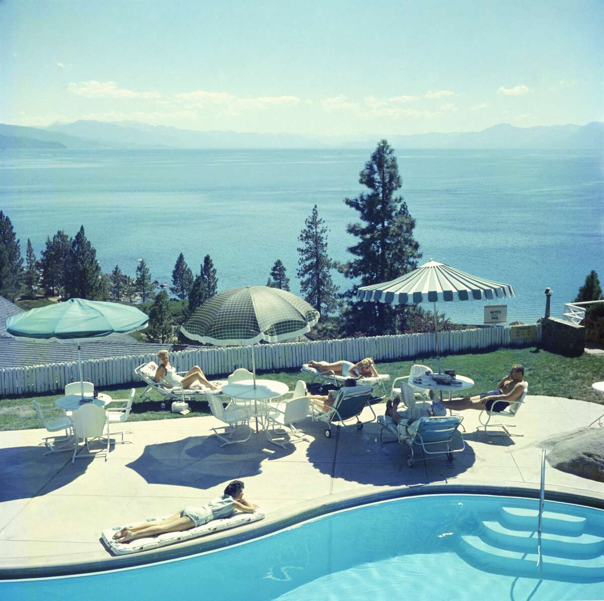 Guests at a swimming pool at the Cal Neva Lodge on the shore of Lake Tahoe in 1959. The resort and casino straddles the border between Nevada and California. It was owned by Frank Sinatra from 1960 to 1968.