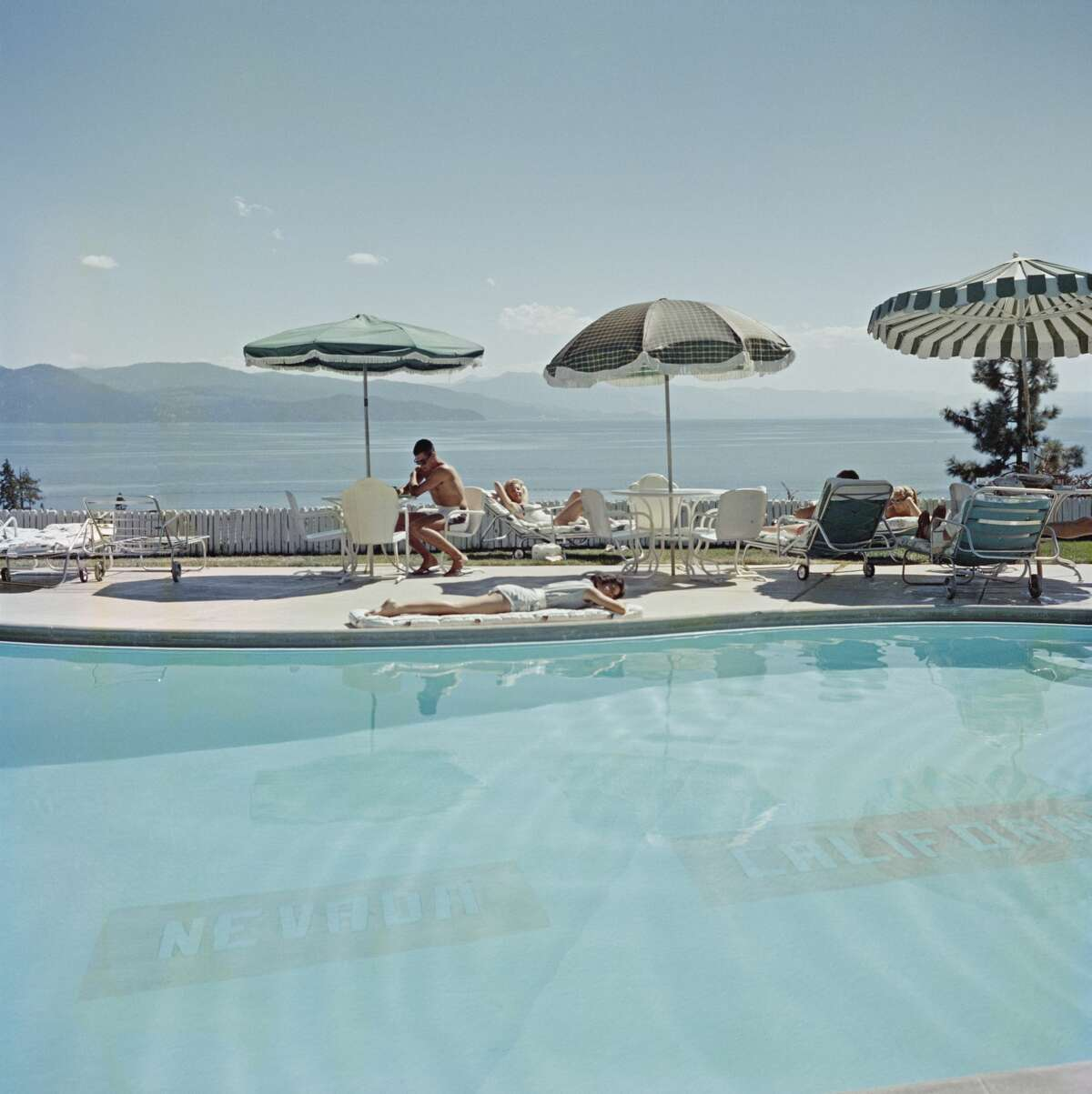 A swimming pool at the Cal Neva Lodge on the shore of Lake Tahoe in 1959. The Cal Neva Lodge straddles the border between Nevada and California and the line on the bottom of the pool marks the state boundary.