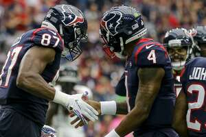Houston Texans tight end Darren Fells (87) celebrates with quarterback Deshaun Watson (4) after a 12-yard touchdown catch during the fourth quarter of an NFL football game at NRG Stadium Sunday, Oct. 6, 2019, in Houston.