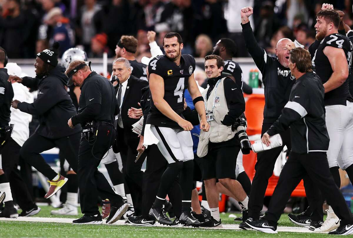 LONDON, ENGLAND - OCTOBER 06: Derek Carr of Oakland Raiders celebrates after the final whistle the game between Chicago Bears and Oakland Raiders at Tottenham Hotspur Stadium on October 06, 2019 in London, England. (Photo by Naomi Baker/Getty Images)
