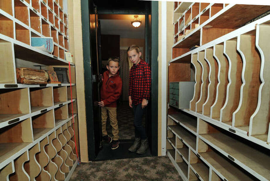 Bennett Leslie, 8, and his sister, Arianne, 12, both of Jerseyville, peer into the Cheney Mansion vault while taking a tour of the historic home. The Jersey County Historical Society offered tours of the mansion and other historic buildings Saturday during the nonprofit organization's 29th annual Apple Festival. Photo: David Blanchette|For The Telegraph