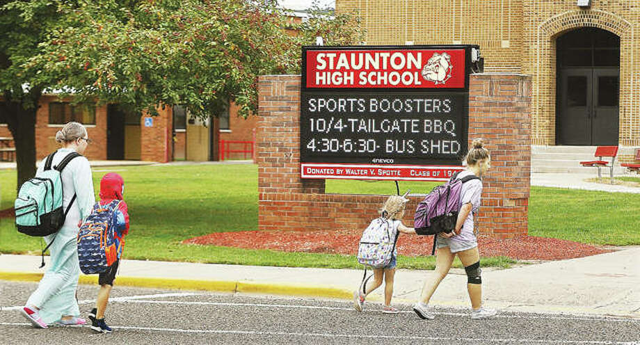 Students head into Staunton High School, and the adjacent elementary school, this week where they were dressed up for an annual homecoming week event. Photo: John Badman|The Telegraph