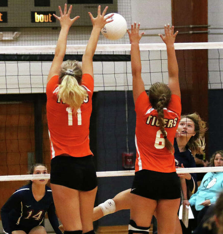 Carlinville's Jill Stayton (right) scores on an attack splitting the block of Greenfield's Kersty Gibbs (11) and Kaitlyn Foiles (6) during a pool-play match Saturday at the Carlinville Tournament. The Cavs swept the Tigers 25-21, 25-11 to win the pool and went on to beat Moweaqua Central A&M in two sets for the tourney championship to cap a 4-0 day that pushed Carlinville's record to 18-5. Greenfield rebounded to beat Carlyle 26-24, 25-12 for third place. The Tigers, who also won pool matches over Springfield Lanphier and Valmeyer, are 16-3. Photo: Greg Shashack / The Telegraph