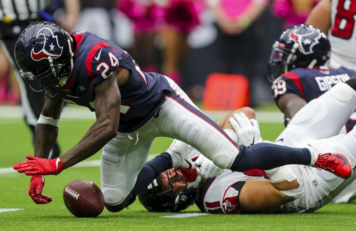 PHOTOS: Texans vs. Chiefs  Houston Texans cornerback Johnathan Joseph (24) recovers what appeared to have been a fumble by Atlanta Falcons quarterback Matt Ryan (2) during the fourth quarter of an NFL football game at NRG Stadium Sunday, Oct. 6, 2019, in Houston. The call was reversed into a touchdown. >>>See more photos from the Texans' win over the Chiefs on Sunday ...