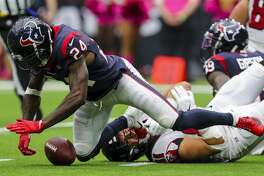 Houston Texans cornerback Johnathan Joseph (24) recovers what appeared to have been a fumble by Atlanta Falcons quarterback Matt Ryan (2) during the fourth quarter of an NFL football game at NRG Stadium Sunday, Oct. 6, 2019, in Houston. The call was reversed into a touchdown.
