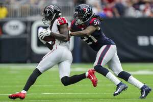 Houston Texans cornerback Bradley Roby (21) tackles Atlanta Falcons wide receiver Calvin Ridley (18) during the third quarter of an NFL football game at NRG Stadium Sunday, Oct. 6, 2019, in Houston.