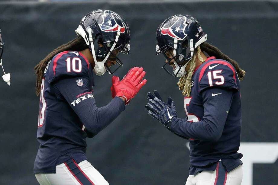 Houston Texans wide receiver Will Fuller (15) celebrates his touchdown with teammate DeAndre Hopkins (10) during the second half of an NFL football game against the Atlanta Falcons, Sunday in Houston. Photo: Michael Wyke, FRE / Associated Press / Copyright 2019 The Associated Press. All rights reserved