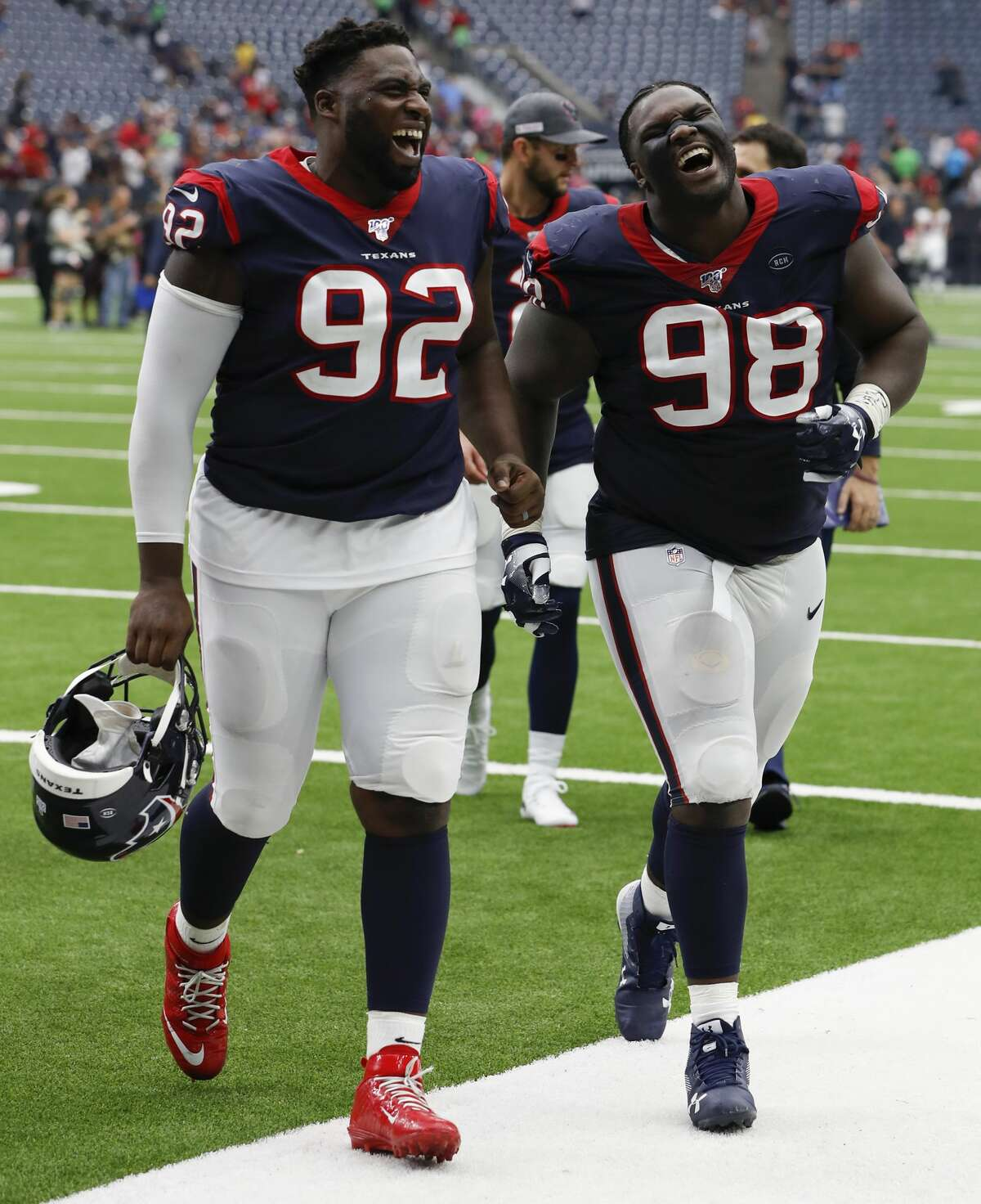 Houston Texans nose tackle Brandon Dunn (92) and defensive end D.J. Reader (98) laugh as they leave the field following the Texans' 53-32 win over the Atlanta Falcons in NFL football game at NRG Stadium on Sunday, monthnameap} 6, 2019, in Houston.