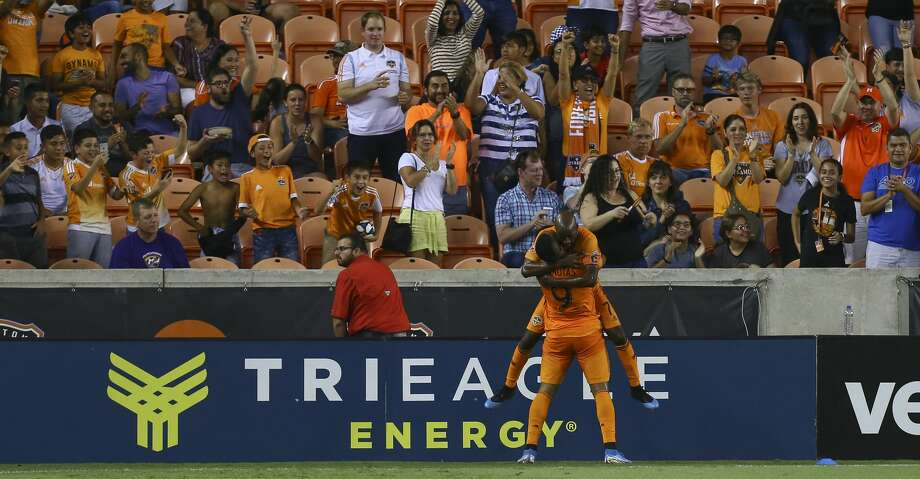 Houston Dynamo forward Mauro Manotas (9) celebrates with midfielder DaMarcus Beasley (7) after scoring a goal against Minnesota United FC during the first half of an MLS match at BBVA Stadium Wednesday, Sept. 11, 2019, in Houston. The Dynamo won 2-0. Photo: Godofredo A Vásquez/Staff Photographer