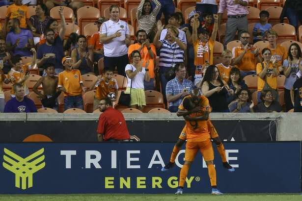 Houston Dynamo forward Mauro Manotas (9) celebrates with midfielder DaMarcus Beasley (7) after scoring a goal against Minnesota United FC during the first half of an MLS match at BBVA Stadium Wednesday, Sept. 11, 2019, in Houston. The Dynamo won 2-0.