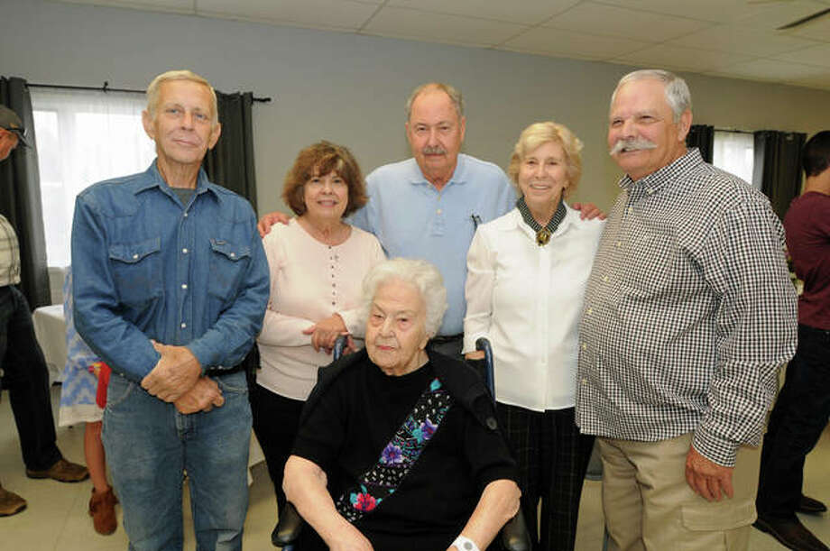 Zella Emde, seated, who turned 100 years old on Oct. 1, with her five children, left to right, Byron Emde, Andrea Emde, Don Emde, Patti Lindley and Dan Emde Saturday at the Bethalto Senior Citizens Center, where she celebrated her milestone birthday at a party with family and friends. Photo: David Blanchette|For The Telegraph