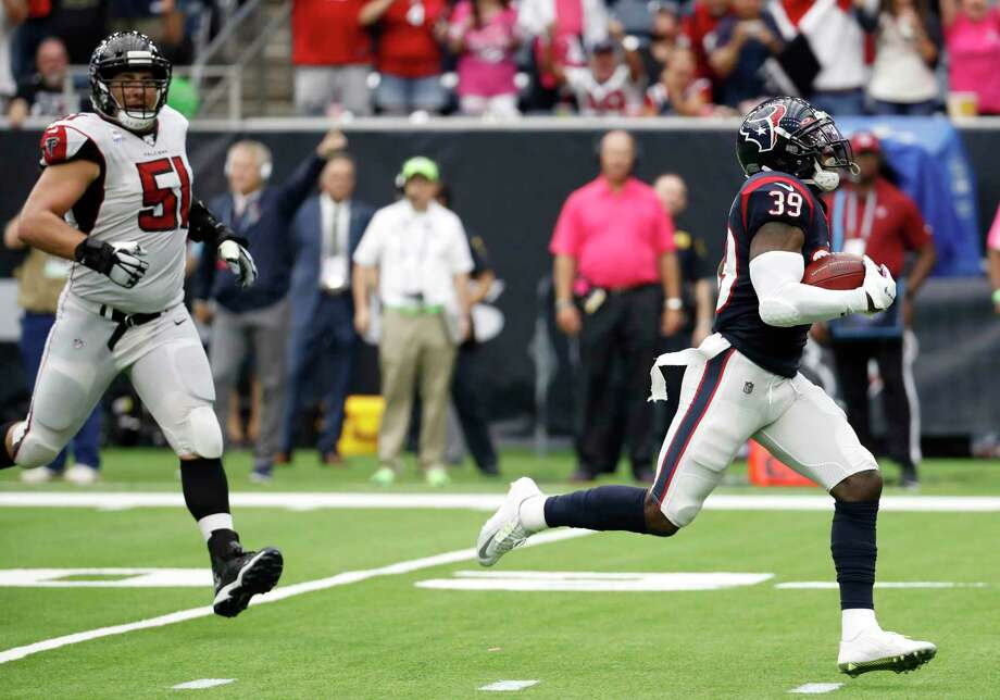 Texans safety Tashaun Gipson zips ahead of Falcons center Alex Mack (51) en route to a 79-yard interception return for a touchdown that sealed Sunday's 53-32 win at NRG Stadium. Photo: Brett Coomer, Houston Chronicle / Staff Photographer / © 2019 Houston Chronicle