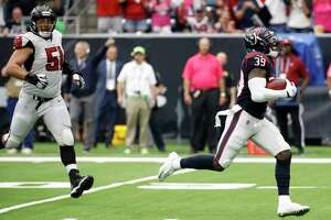 Texans safety Tashaun Gipson zips ahead of Falcons center Alex Mack (51) en route to a 79-yard interception return for a touchdown that sealed Sunday's 53-32 win at NRG Stadium.