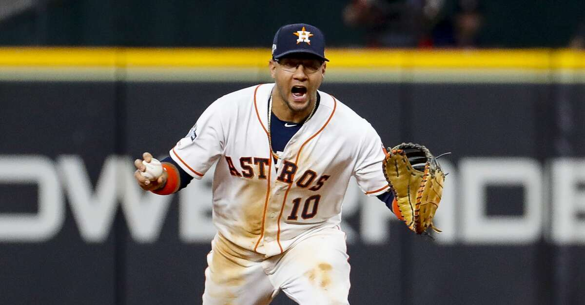 Houston Astros first baseman Yuli Gurriel (10) calls to relief pitcher Will Harris (36) after fielding a ground ball by Tampa Bay Rays center fielder Kevin Kiermaier (39) during the ninth inning of Game 2 of the American League Division Series at Minute Maid Park on Saturday, Oct. 5, 2019, in Houston.