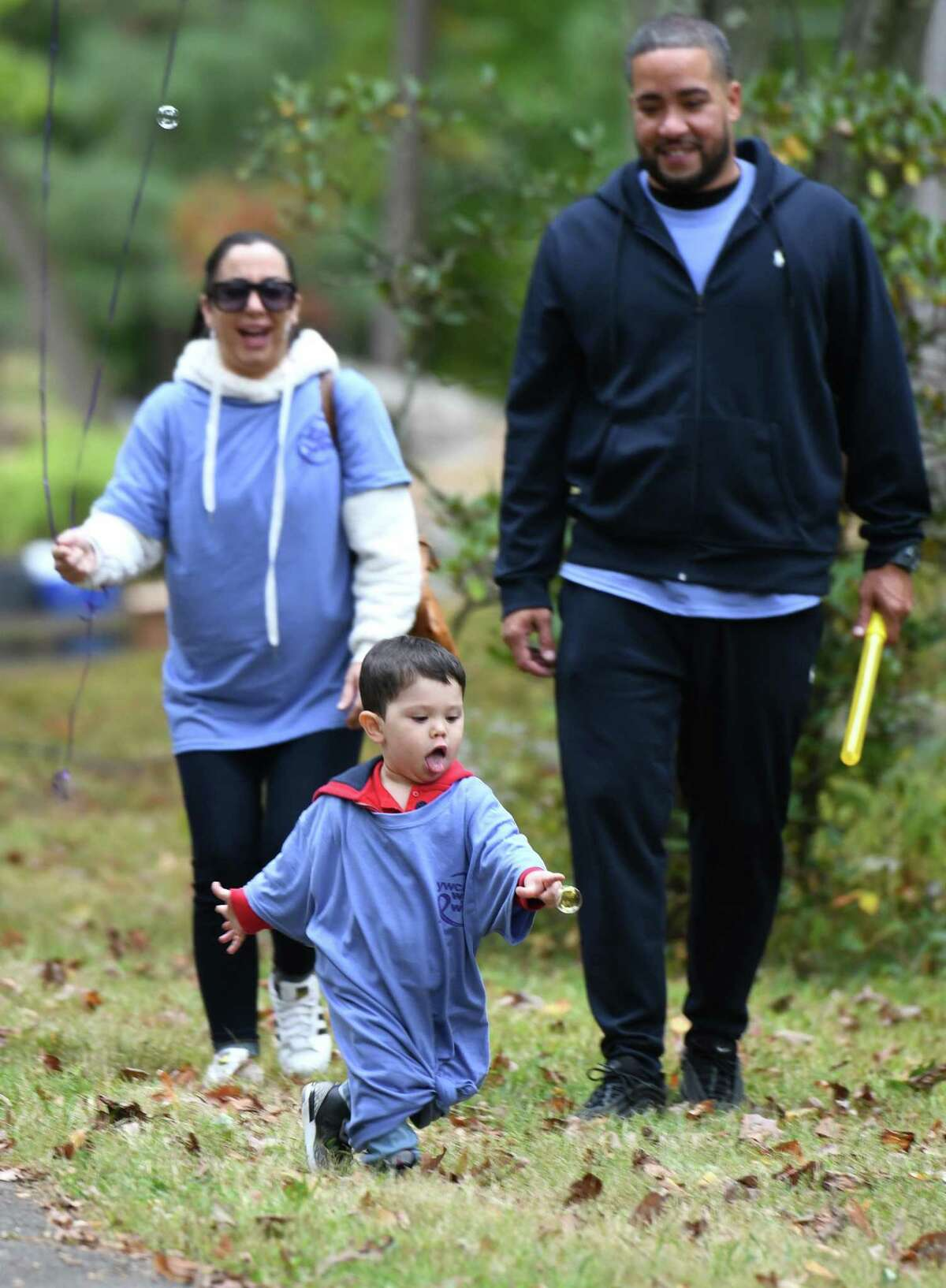 Lucas Rivera, 2, of Bronx, N.Y., pops a bubble while walking in the YWCA Greenwich Walk the Walk Against Domestic Violence at Bruce Park in Greenwich, Conn. Sunday, Oct. 6, 2019. 250 people participated in the walk to raise awareness and funds for the YWCA's domestic abuse services and education. October is Domestic Violence Awareness and Prevention Month and the YWCA provides vital community services to victims of domestic abuse, responding to more than 3,700 calls last year alone.