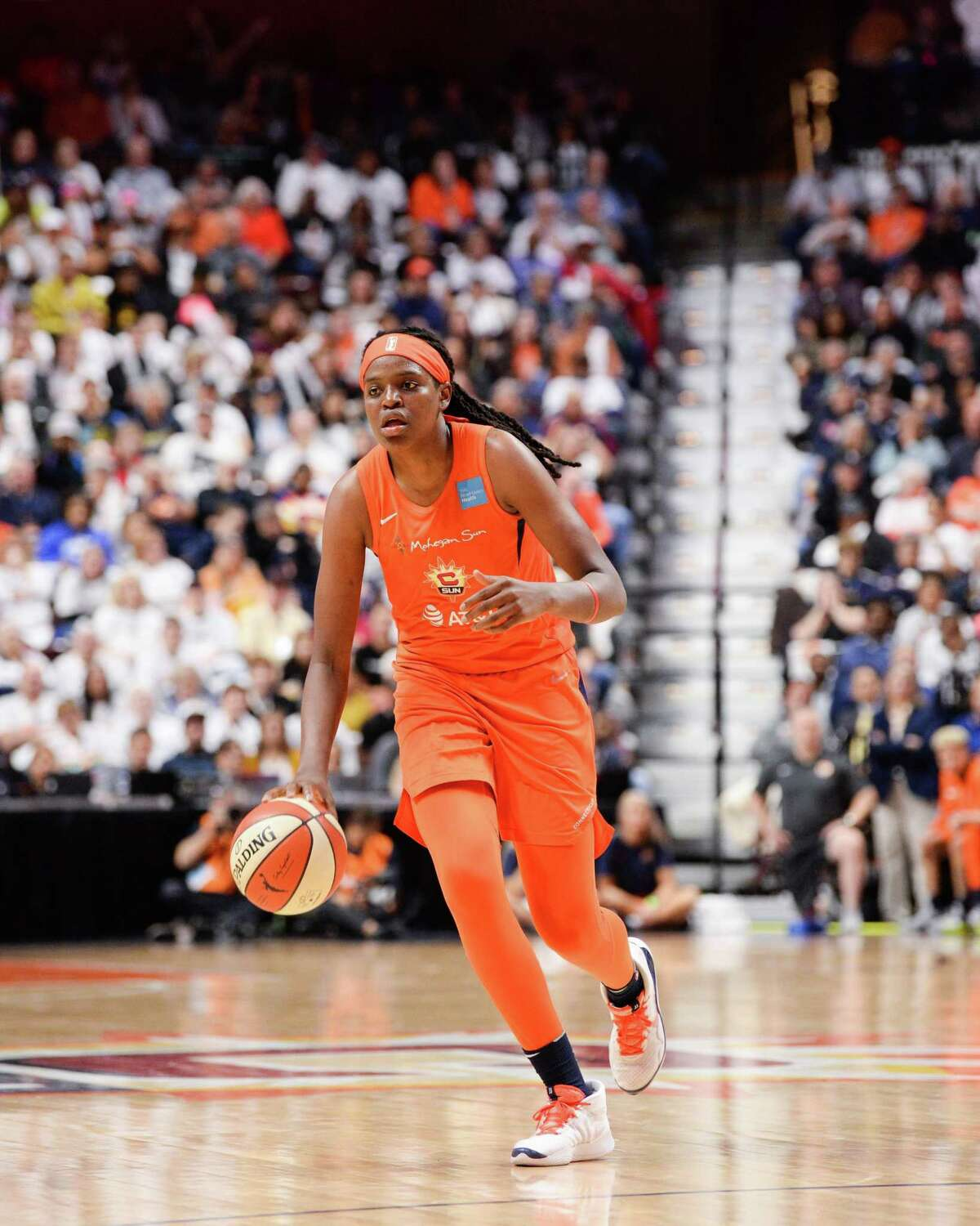 Jonquel Jones of the Connecticut Sun brings the ball up court against the Washington Mystics in the fourth quarter of Game 3 of the WNBA Finals at Mohegan Sun Arena on Oct. 6 in Uncasville. Jones will skip the upcoming WNBA season due to coronavirus concerns.