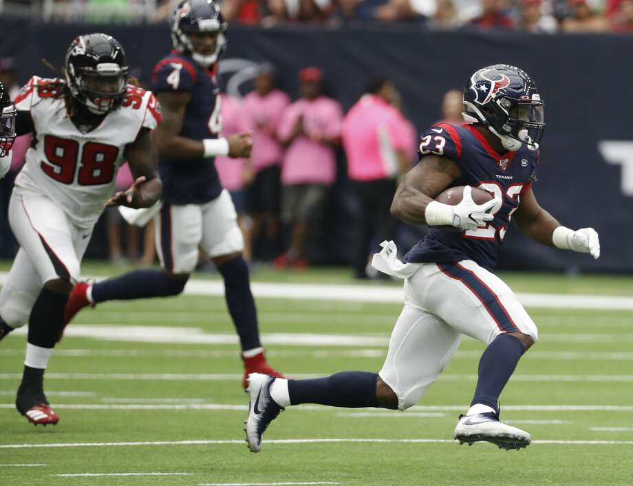 Houston Texans running back Carlos Hyde (23) breaks past Atlanta Falcons defensive end Takkarist McKinley (98) for a first down run during an NFL football game at NRG Stadium on Sunday, Oct. 6, 2019, in Houston. Photo: Brett Coomer/Staff Photographer