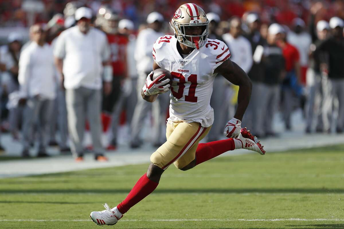 San Francisco 49ers running back Raheem Mostert (31) runs against the Tampa Bay Buccaneers during the first half an NFL football game, Sunday, Sept. 8, 2019, in Tampa, Fla. (AP Photo/Mark LoMoglio)