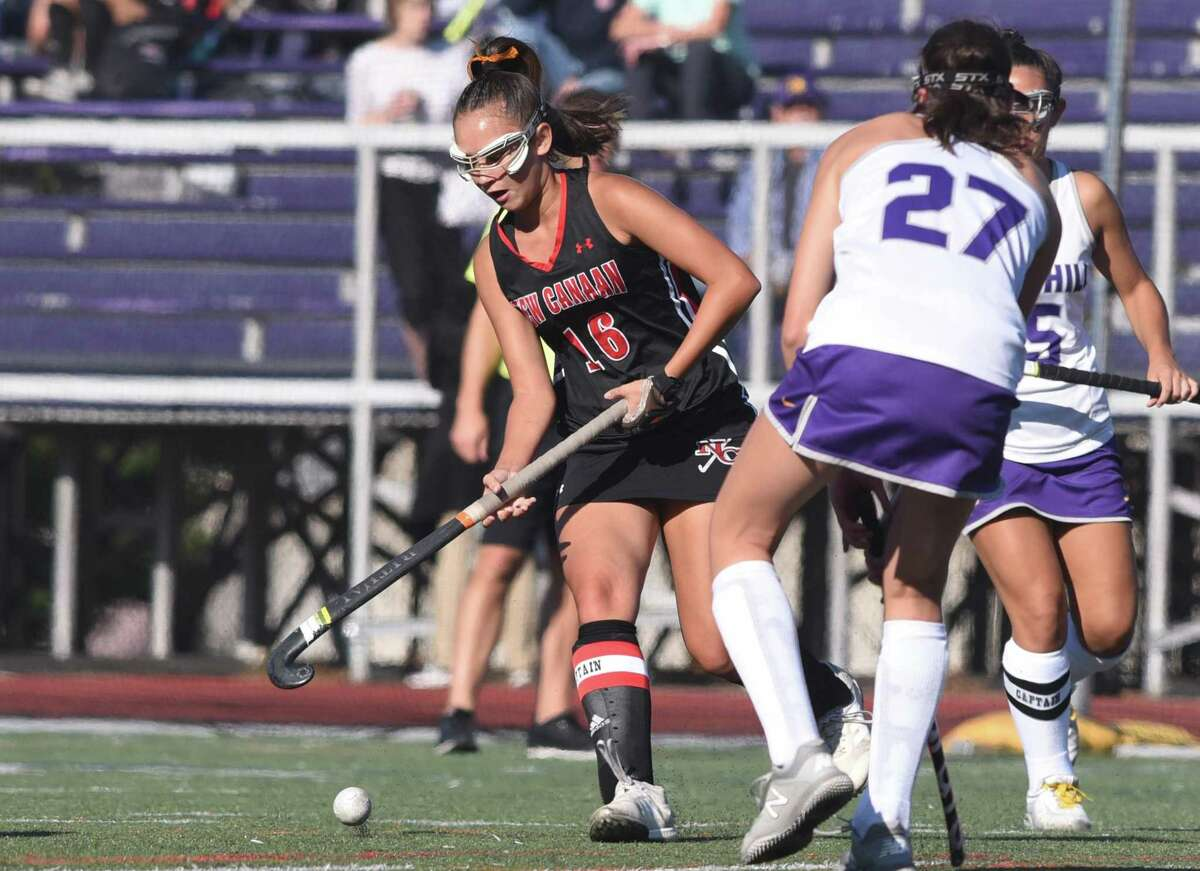 New Canaan's Estelle Asker (16) moves the ball up the field during the Rams' field hockey game at Westhill in Stamford on Sept. 19, 2019.
