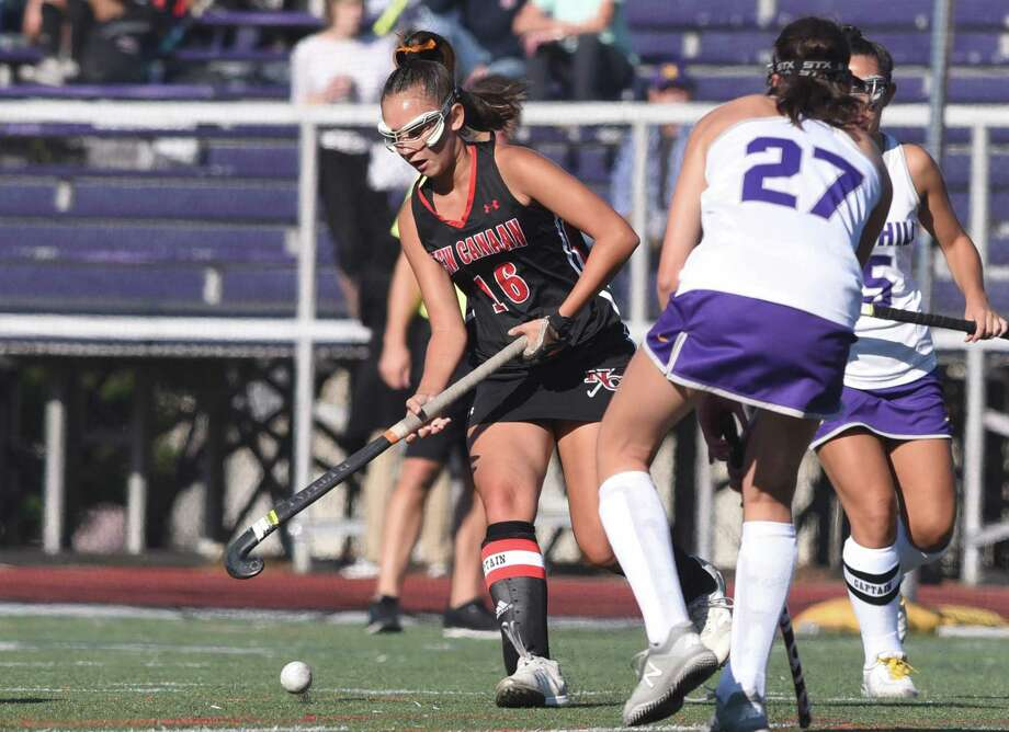 New Canaan's Estelle Asker (16) moves the ball up the field during the Rams' field hockey game at Westhill in Stamford on Sept. 19, 2019. Photo: Dave Stewart / Hearst Connecticut Media / Hearst Connecticut Media