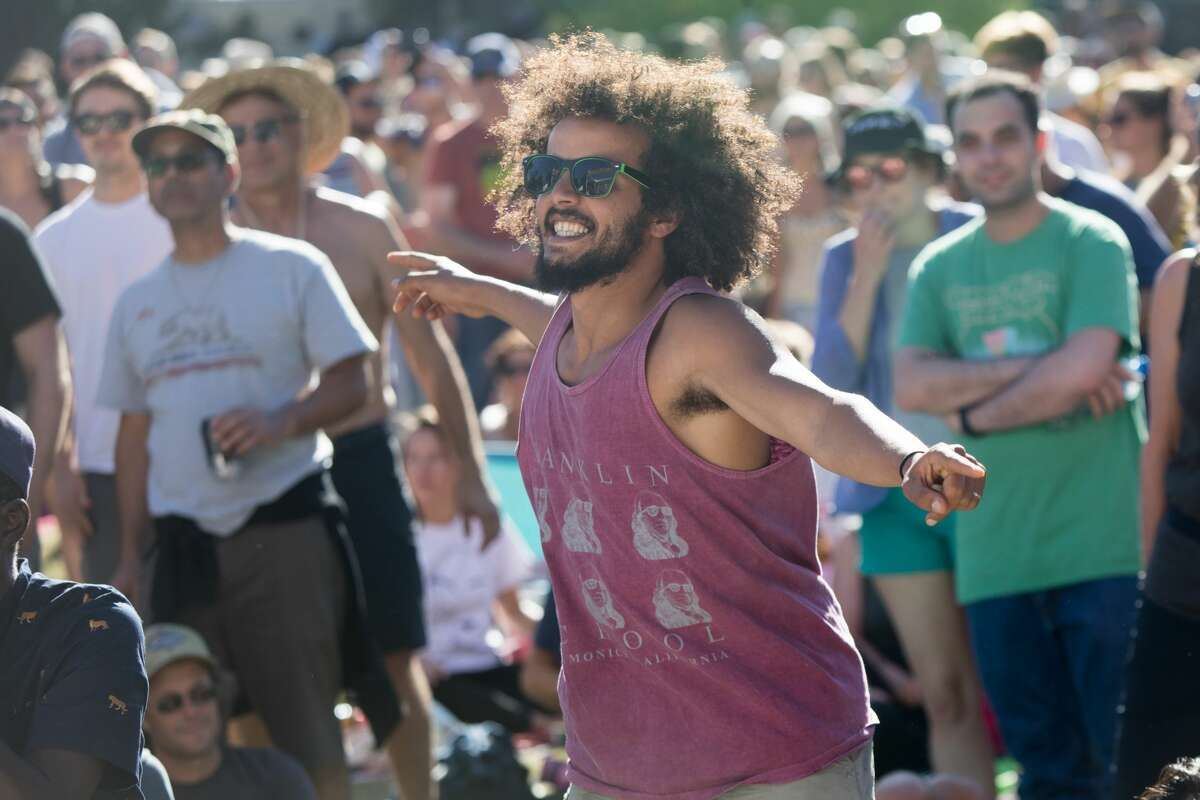 A festivalgoer dances to Modu Moctar as he performs at the Hardly Strictly Bluegrass Festival in Golden Gate Park on October 6, 2019.