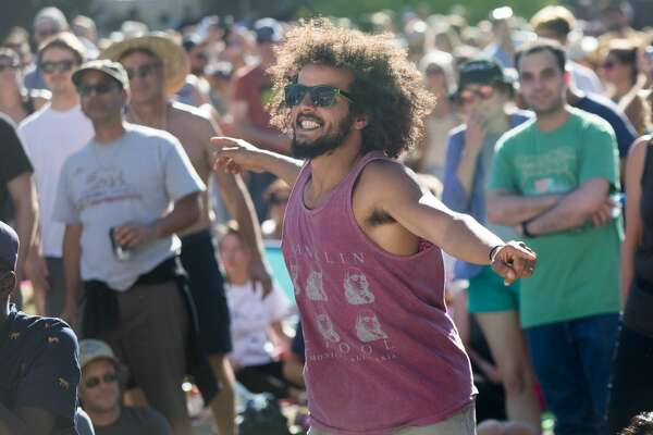 A festival goer dances to Modu Moctar as he performs at the Hardly Strictly Bluegrass Festival in Golden Gate Park on October 6, 2019.