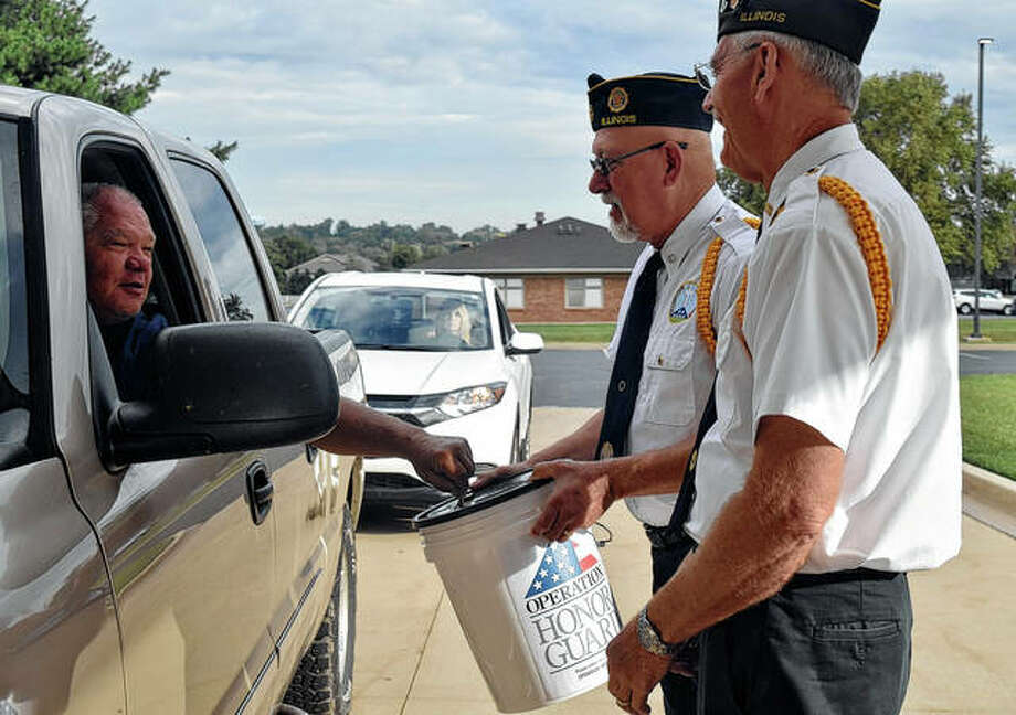 Orville Wheatley (left) donates money to Operation Honor Guard, being collected by Larry Preston and Steve Scott. Photo: Samantha McDaniel-Ogletree | Journal-Courier