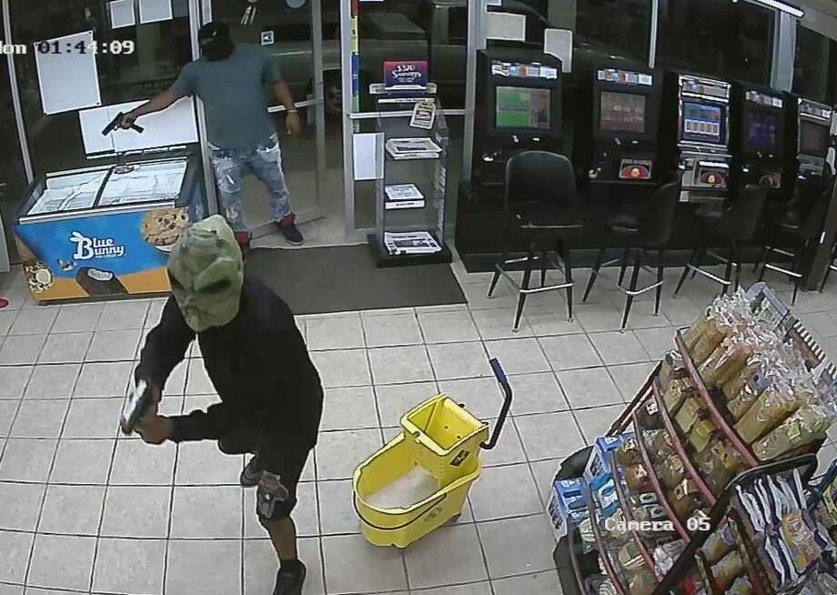 Surveillance stills released by the Houston Police Department show two men suspected in a deadly robbery shooting early Monday, Oct. 7, 2019, in the 2800 block of Reed Road. Photo: Houston Police Department