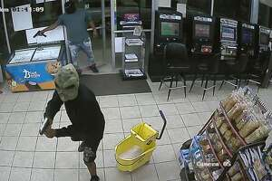 Surveillance stills released by the Houston Police Department show two men suspected in a deadly robbery shooting early Monday, Oct. 7, 2019, in the 2800 block of Reed Road.