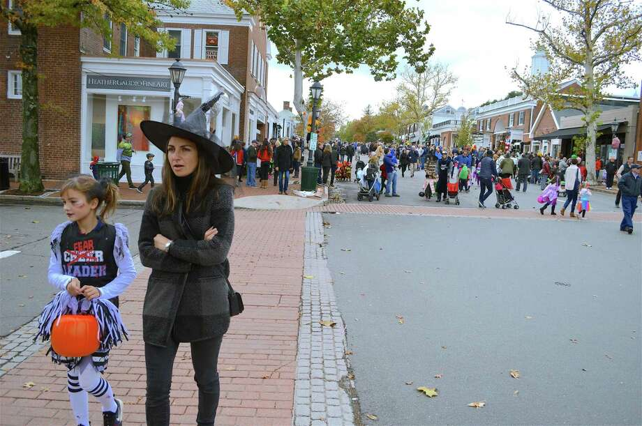 Andrea Johnson of New Canaan and her daughter Serena, 8, were among hundreds of trick-or-treaters on Elm Street at the 40th annual Chamber of Commerce Halloween Parade event, last year, Sunday, Oct. 28, 2018, in New Canaan, Connecticut. There will be a Halloween Block Party instead of a Halloween on this year's date of Oct, 27, 2019. Photo: Jarret Liotta / For Hearst Connecticut Media / New Canaan News Freelance