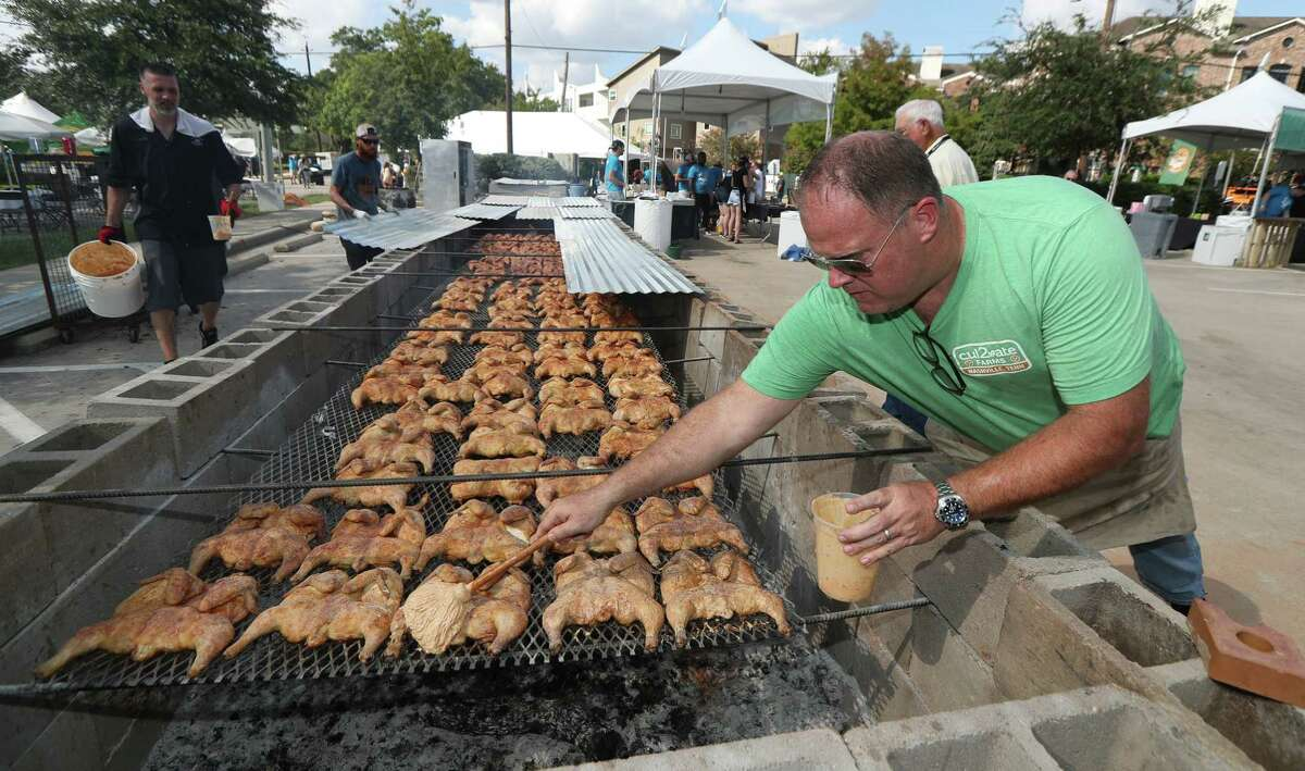 Chef Pat Martin of Martin's Bar-B-Que Joint in Nashville checks on his smoked chickens at the 2019 Southern Smoke festival.