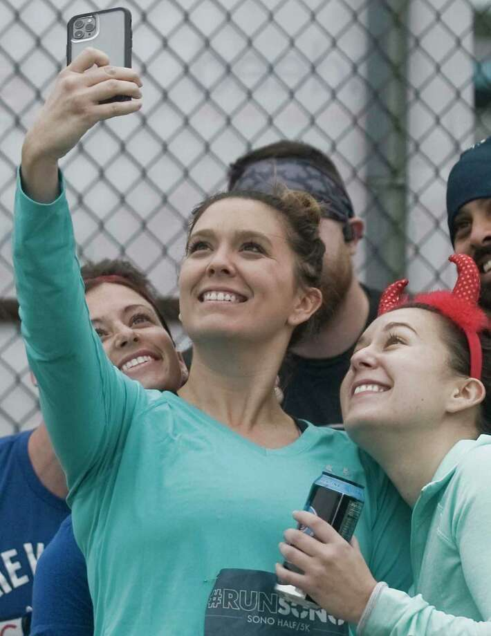 Kristin Wilson, of Stamford, Nicole Krize, of Stamford, and Leigha Krize, of Fairfield, make a picture before starting the SoNo Half Marathon/5K race at Veteran's Memorial Park. Sunday, Oct. 6, 2019 Photo: Scott Mullin / For Hearst Connecticut Media / The News-Times Freelance