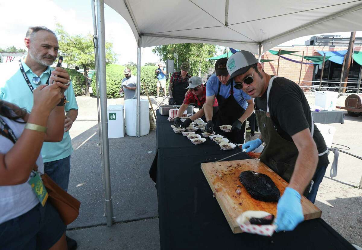 Aaron Franklin's slices up his world-famous brisket during the 2019 Southern Smoke festival.