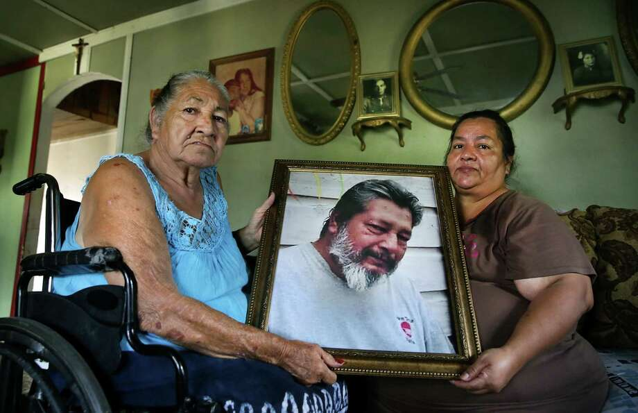 A picture of Narciso Ricarte Jr. is held by his mother, Oralia Ricarte, and sister, Oralia Guajardo. He was found dead at San Antonio State Hospital in June from what appears to be heart failure. Photo: Bob Owen /Staff Photographer / ©2019 San Antonio Express-News