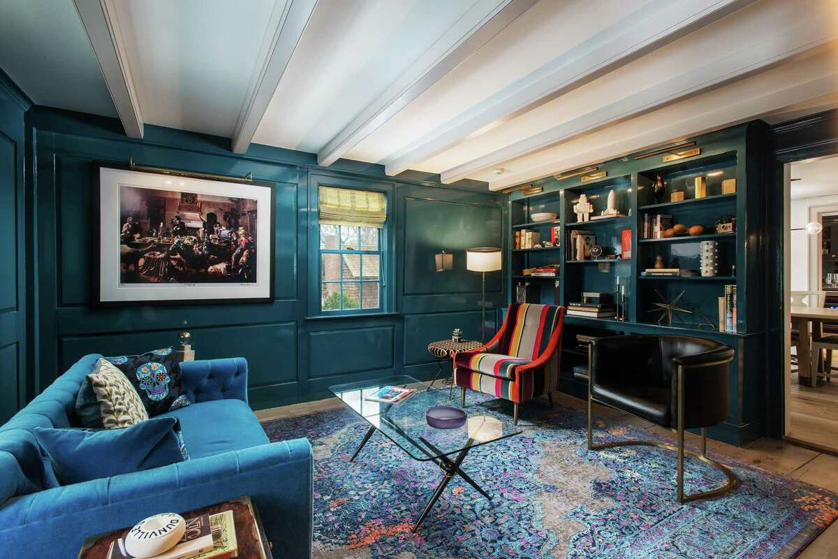 The home's otherwise traditional, Colonial style library was transformed into a hip, funky space with turquoise lacquer paint.