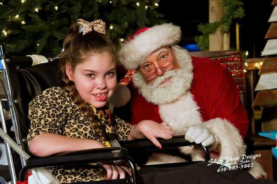 Five years ago, Tess Drainer, pictured here with Jerseyville's own official Santa Claus (known to many as Steve Pegram) wanted to bring the holiday spirit alive to the entire community. The annual Downtown Country Christmas Festival will mark its fifth year Nov. 30 in Jerseyville's downtown merchant district and Courthouse Square.