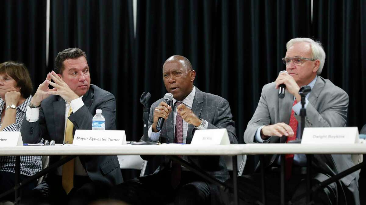 Bill King, shown here on right, reported $263,000 cash on hand heading into the stretch run of the mayor's race. Mayor Sylvester Turner, center, reported taking in $733,000. He had $1.62 million in cash on hand, according to his campaign finance report. Challenger Tony Buzbee's report shows he has added another $2.5 million to his campaign, bringing his self-funding total to $10 million.