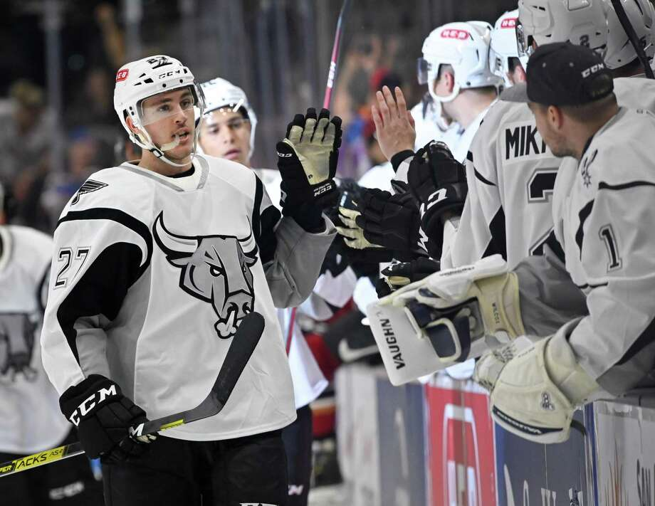San Antonio Rampage right wing Zach Nastasiuk (27) celebrates his second goal of the game with players on the San Antonio bench during the third period of an AHL hockey game against the Tucson roadrunners, Sunday, Oct. 6, 2019, in San Antonio, Texas. San Antonio won 5-2. (Darren Abate/AHL) Photo: Darren Abate, STF / Darren Abate/AHL / Darren Abate Media, LLC