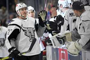 San Antonio Rampage right wing Zach Nastasiuk (27) celebrates his second goal of the game with players on the San Antonio bench during the third period of an AHL hockey game against the Tucson roadrunners, Sunday, Oct. 6, 2019, in San Antonio, Texas. San Antonio won 5-2. (Darren Abate/AHL)