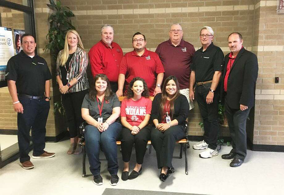Administrators and community supporters joined Alicia Vanek in celebrating her being named the Cleveland ISD Teacher of the Week. From left standing, Caleb Flores with DeMontrond Ford, CHS Administrator Dr. Kristy Dietrich, CISD Superintendent of Schools Chris Trotter, Waldo Rodas and Jeff McClain with KORG-LP 95.3 Radio, Bruce Martin with DeMontrond Ford, and CISD Asst. Superintendent of HR Dr. Nathan Boughton. Seated from left, CISD CFO Karen Billingsley, CISD Teacher of the Week Alicia Vanek, and CISD Asst. Superintendent Curriculum and Instruction Maria Silva. The award is sponsored by KORG-LP 95.3 Radio, DeMontrond Ford, Health Center of Southeast Texas, El Burrito, and Easy Street Florist. Photo: David Taylor / Staff Photo