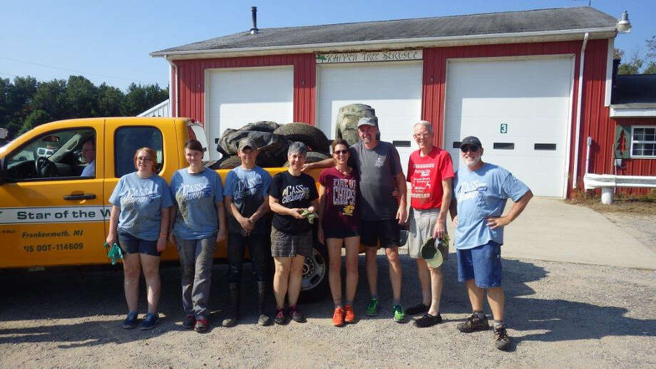 This team of CRG volunteers performed a phenominal effort in extracting a truckload of tires from the Cass River on Sept. 21. Photo: Tom Lounsbury/Hearst Michigan