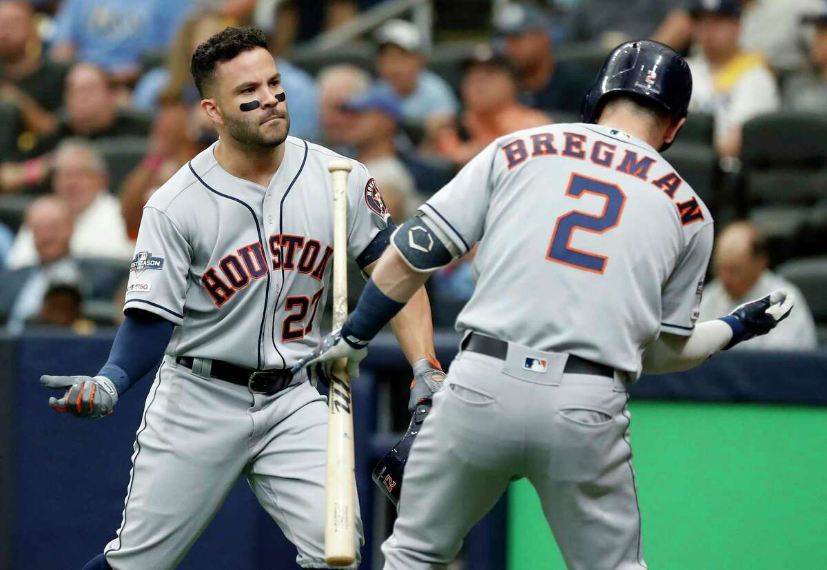 Houston Astros second baseman Jose Altuve (27) and third baseman Alex Bregman celebrate Altuve's solo home run off Tampa Bay Rays starting pitcher Charlie Morton during the first inning of Game 3 of the American League Division Series at Tropicana Field on Monday, Oct. 7, 2019, in St. Petersburg, Fla.