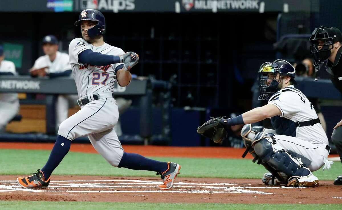Houston Astros second baseman Jose Altuve (27) watches the flight of his solo home run off Tampa Bay Rays starting pitcher Charlie Morton during the first inning of Game 3 of the American League Division Series at Tropicana Field on Monday, Oct. 7, 2019, in St. Petersburg, Fla.