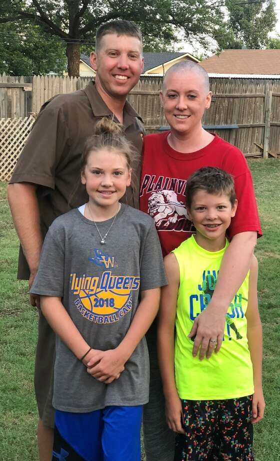 When Lacy Kerbo's hair started to fall out, she made a celebration of it and let her kids shave her head. Kelly and Lacy Kerbo are shown with Ailey and Braedyn who were 10 and 8 at the time. Photo: Courtesy Photo