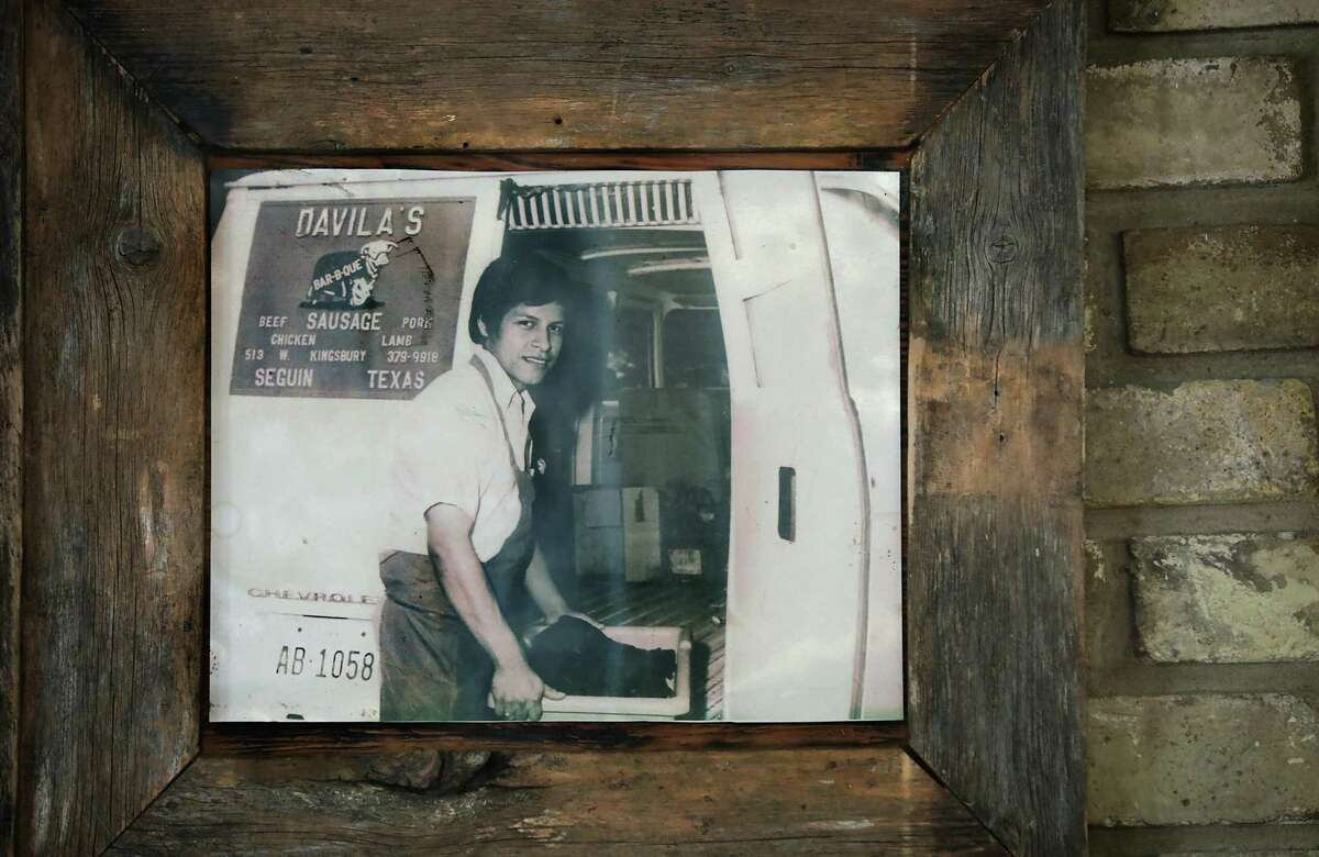 A much younger Edward Davila is seen in a photo hanging in the restaurant. He's been in the barbecue business for more than 60 years.