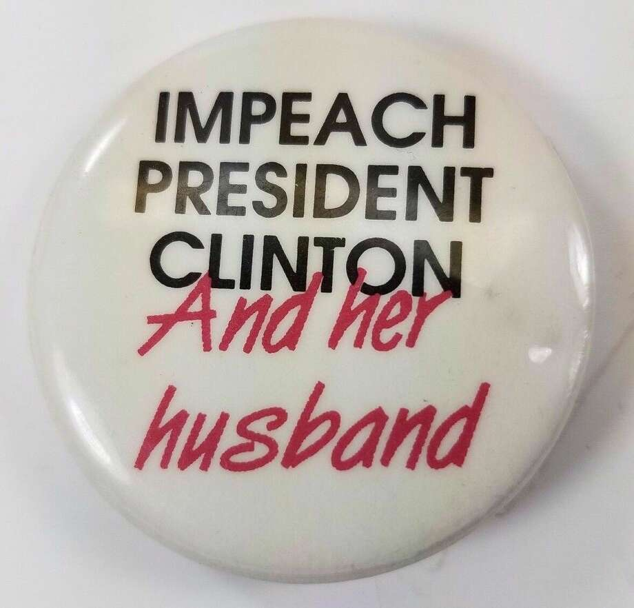 This button suggests that both Clintons should be impeached, long before Hillary was a presidential contender. Photo: Ebay.com