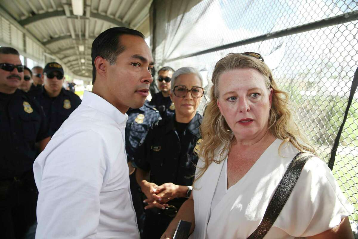 Julián Castro, former U.S. Secretary of Housing and Urban Development and Democratic candidate for president, talks with immigration attorney Jodi Goodwin on Monday in Matamoros. They successfully petitioned U.S Custom and Immigration official for an interview at the international bridge between Brownsville and Matamoros. Castro visited a migrant camp in Matamoros before crossing with a group of LGBTQ and disabled refugees seeking asylum.